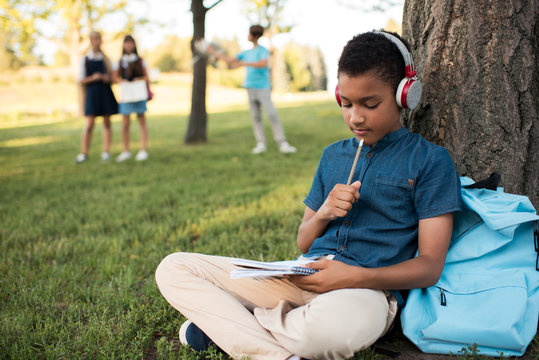 african american boy studying in park