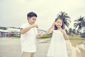 Two children having fun with bubbles