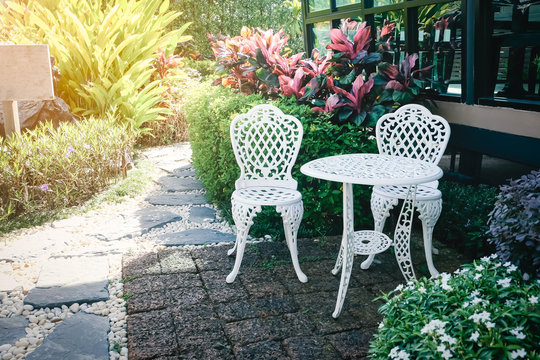 Chairs in the garden in the morning.