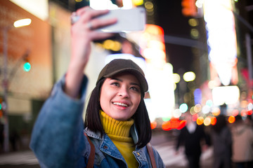 Female traveller taking selfie in Times Square