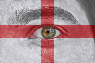 Human face and eye painted with flag of England