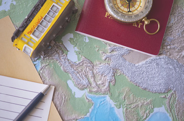Geographical map and accessories for travel on the desk, conceptual picture about travels
