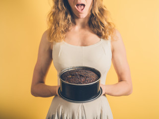 Surprised woman with burnt cake