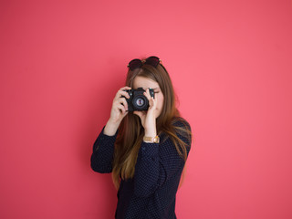 girl taking photo on a retro camera