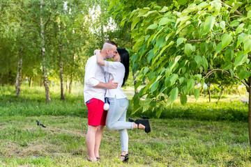 Young couple walking in summer park
