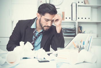 Spanish male worker is having complicated issue with project