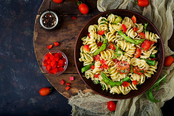 Salad - fusilli pasta with tomatoes, asparagus and sweet pepper