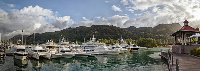 A few luxury yachts at the berth of Eden island, Seychelles