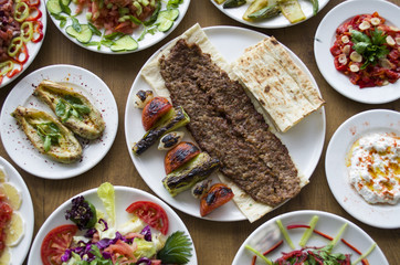 Adana Kebab; healthy and fresh salad varieties and appetizer on wooden table