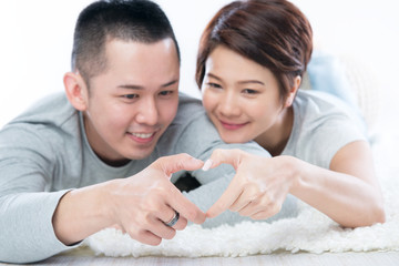 Asian Couple Doing the Symbol of Love