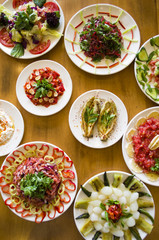healthy and fresh salad varieties and mezes on wooden table