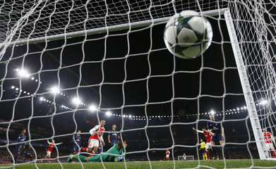 Paris Saint-Germain's Marco Verratti scores an own goal and the second goal for Arsenal