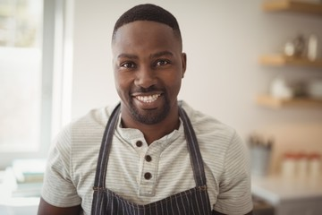 Smiling man standing in kitchen