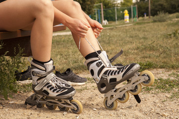 teenage girl prepares for running on inline skates