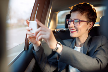 woman enjoy on the traveling and taking photos from a car.