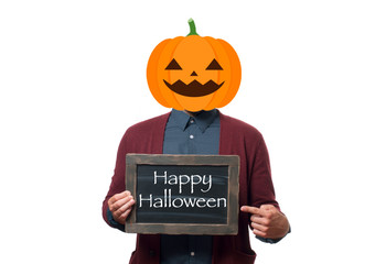 Man with the head of a pumpkin holding chalkboard with text  Happy Halloween.