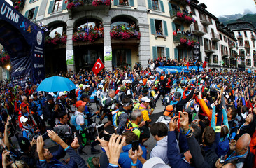 Participants start the 15th Ultra-Trail du Mont-Blanc (UTMB) race in Chamonix