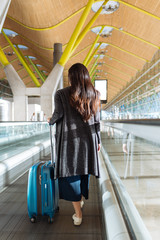 Woman walking on a Moving Walkway in an Airport
