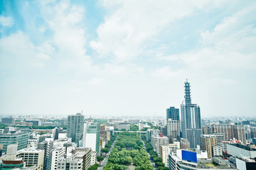 Fototapete - Business concept for real estate and corporate construction - panoramic modern city skyline bird eye aerial view under dramatic cloud and morning bright blue sky on Nagoya TV Tower in Nagoya, Japan