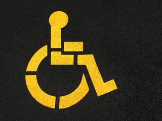 Handicap Wheelchair Symbol Painted on Asphalt