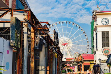 Asiatique shopping mall with Asiatique Ferris Wheel in background. Asiatique is largest lifestyle shopping mall in Bangkok, Thailand