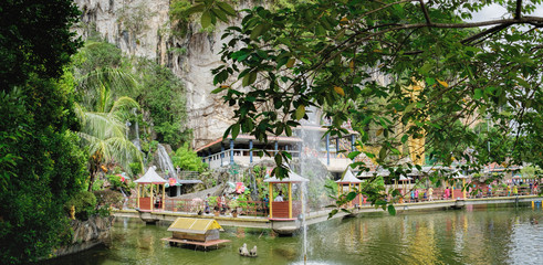Beautiful pond with gazebo for walking tourists at the entrance to the Batu Caves, Malaysia