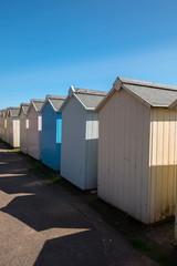 Row of beach huts on Budleigh Salterton beach