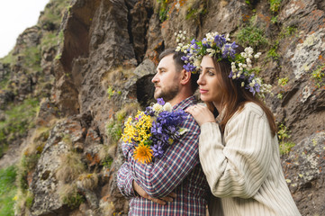 Young couple hipster hugging in nature