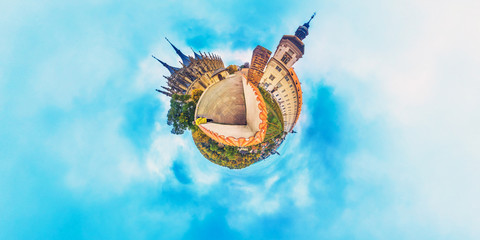Orange little planet panorama with cathedrals and cyan sky. Europe, Czech, Kutna Gora.