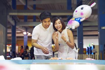Beautiful couple having fun at a carnival in Singapore