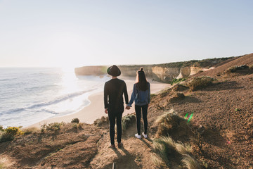 Young couple walking down the Beach in Australia
