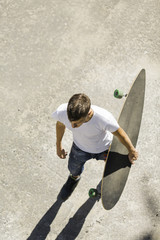 young man with longboard on the street