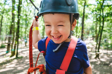 Toddler Boy with Harness and Helmet at the Adventure Park