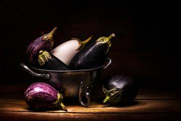 eggplants inside vintage colander