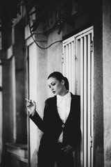 fashionable portrait of a girl in tuxedo