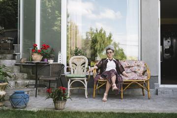 Progressive senior woman portrait in front of her home