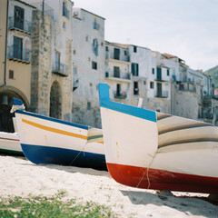 Small boats on Cefalu beach on northern coast of Sicily