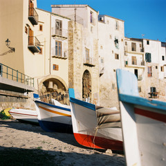 Small boats in on Cefalu beach on northern coast of Sicily