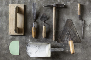 Masonry tools on stone background
