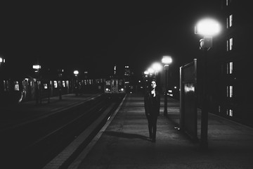 Woman walking in train station at night