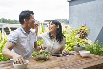 Enjoying their healthy salad outdoors