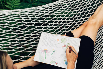 Woman on hammock journaling