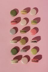 Colorful macarons on pink
