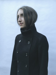 Portrait of cool thirteen year old girl, wearing peacoat