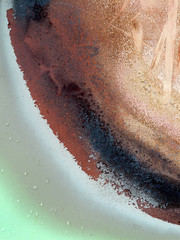 Detail of rust and scratch marks on metal trash canister