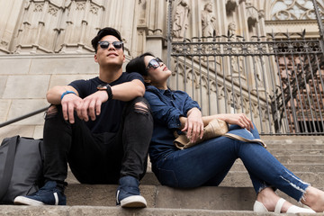 Chinese couple enjoying the view in Barcelona city.