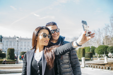 Chinese tourist taking selfies around Palacio Real of Madrid