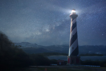 A lighthouse under night sky Wall mural