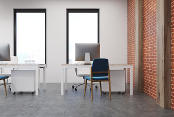 Open space office interior, brick wall