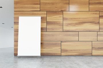 Vertical poster on office floor, wood